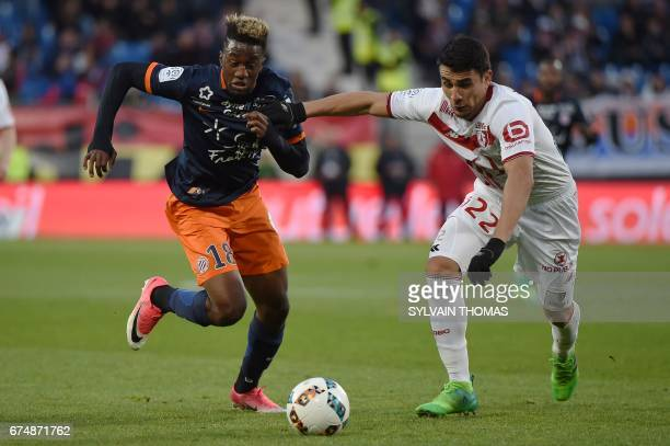 Montpellier's forward Isaac Mbenza vies with Lille's defender Junior Alonso during the French L1 football match between Montpellier and Lille at...