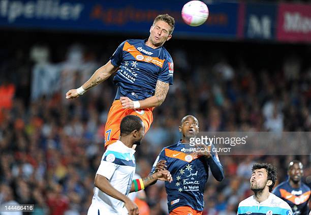 Montpellier's forward Olivier Giroud kicks the ball during the French L1 football match Montpellier vs Lille on May 13 2012 at the Mosson stadium in...