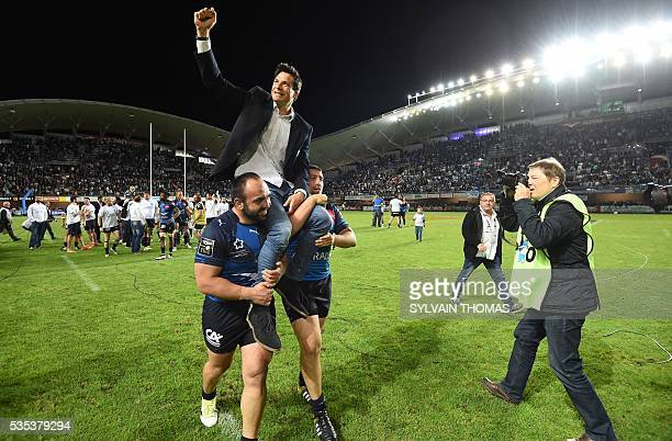 Montpellier's Francois Trinh Duc is congratulated by teammates after the French Top 14 rugby Union match Montpellier vs Toulon on May 29 at the...