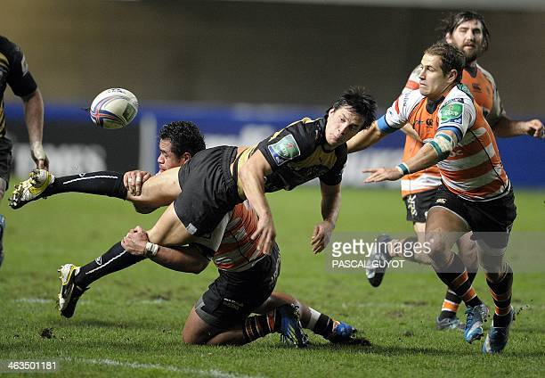 Montpellier's François TrinhDuc is tackled by Treviso's Christian Loamanu during the European Cup rugby union match Montpellier vs Treviso at the...