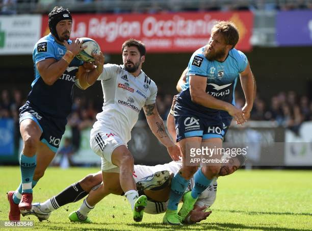 Montpellier's French centre Alexandre Dumoulin runs with the ball after a pass from South African centre François Steyn as Brive's French centre...
