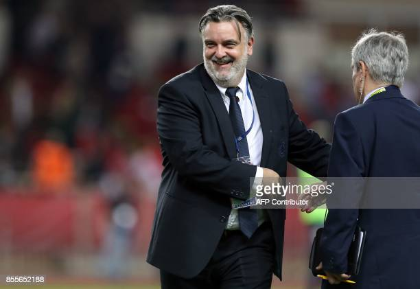 Montpellier's French club president Laurent Nicollin reacts at the end of the French L1 football match between Monaco and Montpellier on September 29...