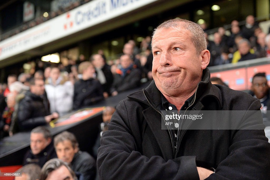 Montpellier's French coach Rolland Courbis looks on during the French L1 football match between Rennes and Montpellier on February 15, 2014 at the Route de Lorient stadium in Rennes, western France. AFP PHOTO / THOMAS BREGARDIS