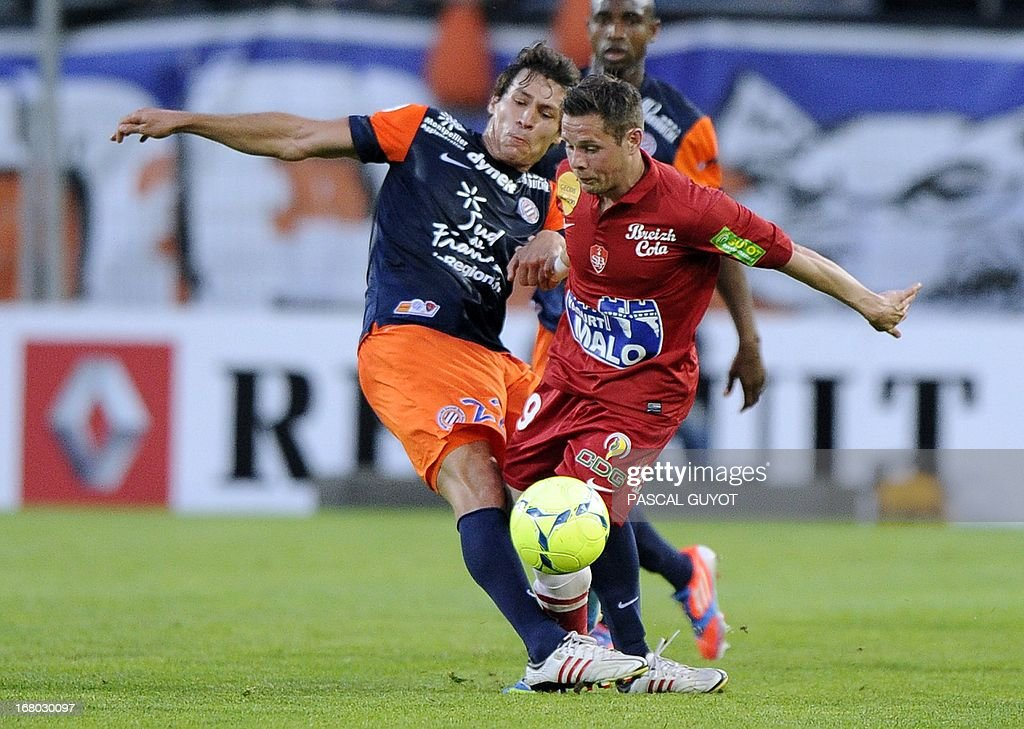 Montpellier's French defender Benjamin Stambouli (L) vies with Brest's French midfielder Benoit Lesoimier (R) during the French L1 football match Montpellier vs Brest on May 4, 2013 at the Mosson stadium in Montpellier, southern France.