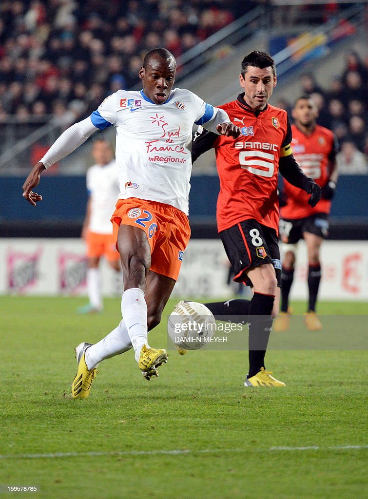 Montpellier's French defender Bryan Dabo (L) fights for the ball with Rennes' French midfielder Julien Feret during the French League Cup semifinal football match Rennes against Montpellier on January 16, 2013 at the route de Lorient stadium in Rennes, western France.