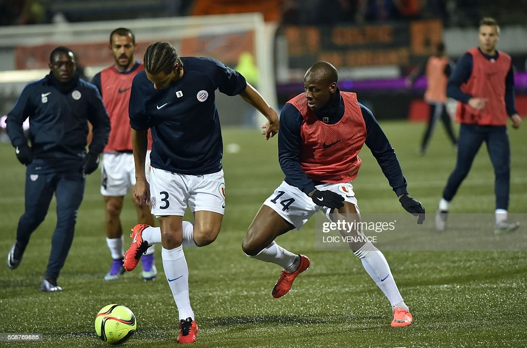 Montpellier's French defender Daniel Congre (L) and Montpellier's French midfielder Bryan Dabowarm up prior to the French L1 football match between Lorient and Montpellier on February 6, 2016 at the Moustoir stadium in Lorient, western France. AFP PHOTO / LOIC VENANCE / AFP / LOIC VENANCE