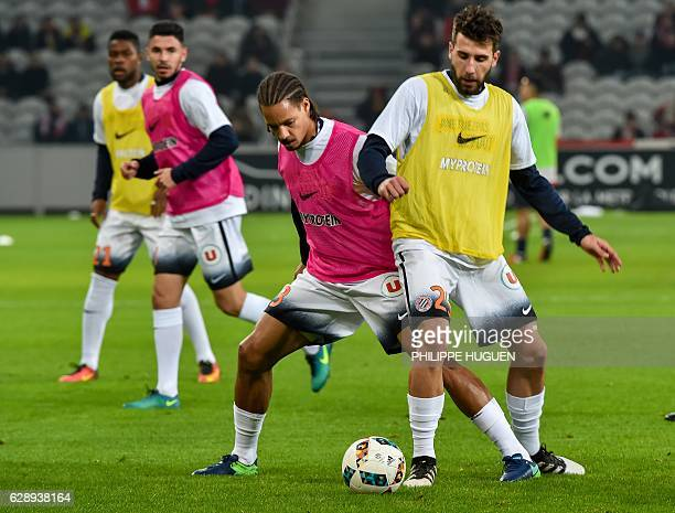 Montpellier's French defender Daniel Congre and Montpellier's French defender Mathieu Deplagne warm up ahead of the French L1 football match Lille vs...