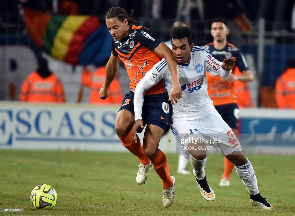 Montpellier's French defender <a gi-track='captionPersonalityLinkClicked' href=/galleries/search?phrase=Daniel+Congre&family=editorial&specificpeople=2167788 ng-click='$event.stopPropagation()'>Daniel Congre</a> (L) challenges Marseille's forward Abdel Omrani (R) during the French L1 football match between Montpellier and Marseille at the La Mosson Stadium in Montpellier, southern France, on January 9, 2015.
