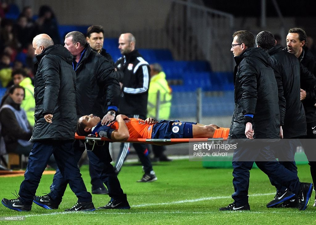 Montpellier's French defender <a gi-track='captionPersonalityLinkClicked' href=/galleries/search?phrase=Daniel+Congre&family=editorial&specificpeople=2167788 ng-click='$event.stopPropagation()'>Daniel Congre</a> is carried after being injured during the French L1 football match between Montpellier and Lyon on March 8, 2015 at the La Mosson Stadium in Montpellier, southern France.