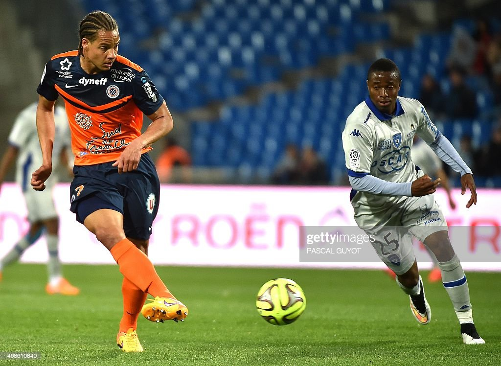 Montpellier's French defender <a gi-track='captionPersonalityLinkClicked' href=/galleries/search?phrase=Daniel+Congre&family=editorial&specificpeople=2167788 ng-click='$event.stopPropagation()'>Daniel Congre</a> (L) vies with Bastia's Guinean forward Francois Kamano (R) during the French L1 football match between Montpellier and Bastia, on April 4, 2015 at La Mosson Stadium in Montpellier, southern France.