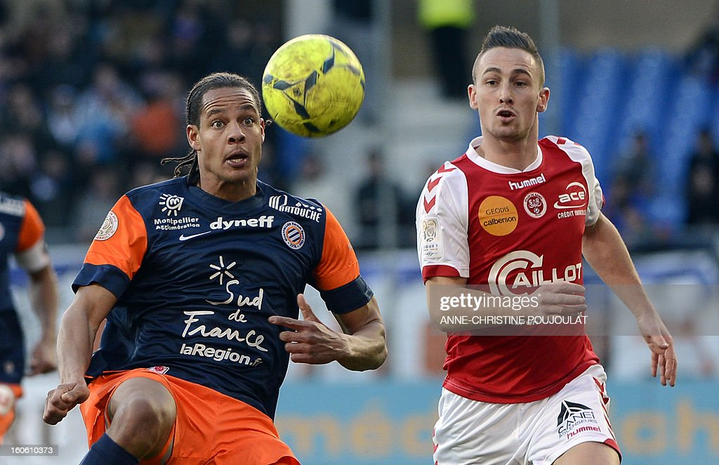 Montpellier's French defender Daniel Congre (L) vies with Reims' French forward Gaetan Courtet (R) during the French L1 football match Montpellier vs Reims on February 3, 2013 at the Mosson stadium in Montpellier, southern France.
