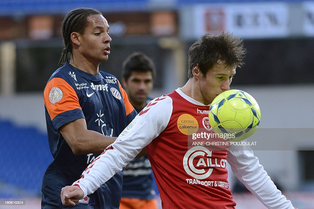 Montpellier's French defender Daniel Congre (L) vies with Reims' Polish midfielder Grzegorz Krychowiak (R) during the French L1 championships football match Montpellier vs Reims on February 3, 2013 at the Mosson stadium in Montpellier.