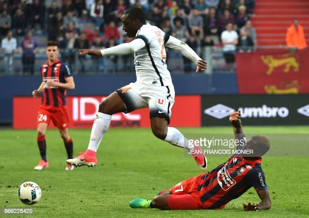 Montpellier's French defender Jerome Roussillon vies for the ball with Caen's French forward Yann Karamoh during the French L1 football match between...