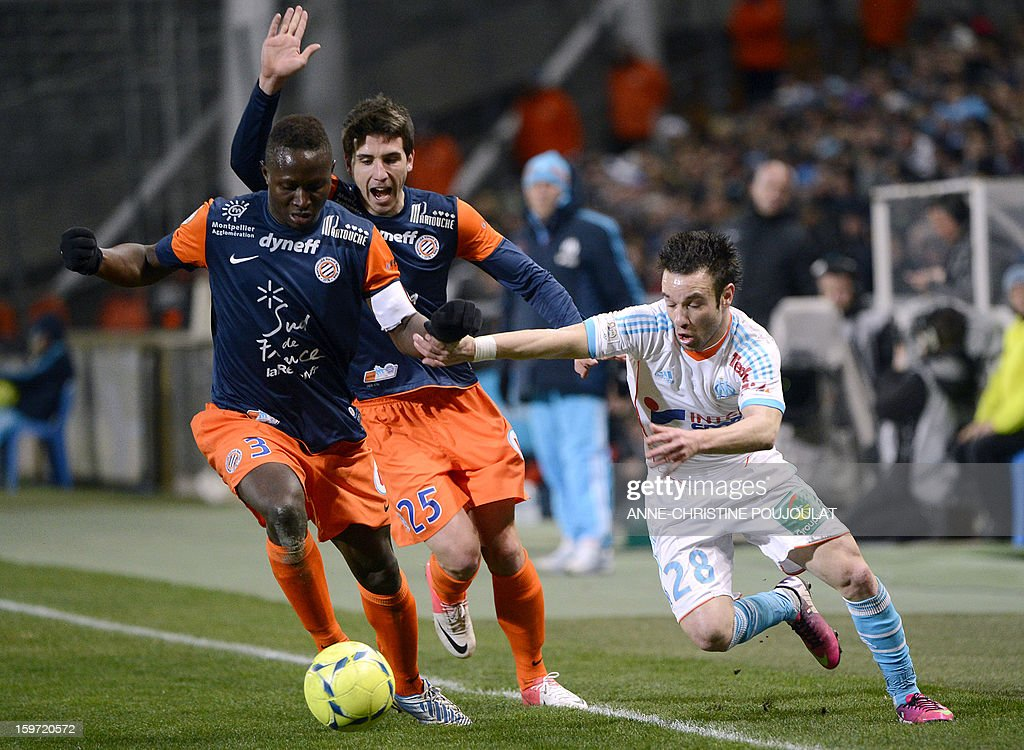 Montpellier's French defender Mapou Yanga-Mbiwa (L) vies with Marseille's French midfielder Mathieu Valbuena (R) during the French L1 football match Marseille (OM) vs Montpellier (MHSC) on January 19, 2013 at the Velodrome stadium in Marseille, southern France.