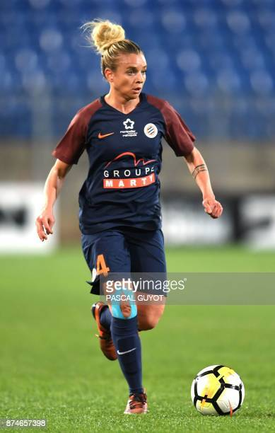 Montpellier's French defender Marion Torrent runs with the ball during the UEFA Women's Champions League eighth finals football match between...