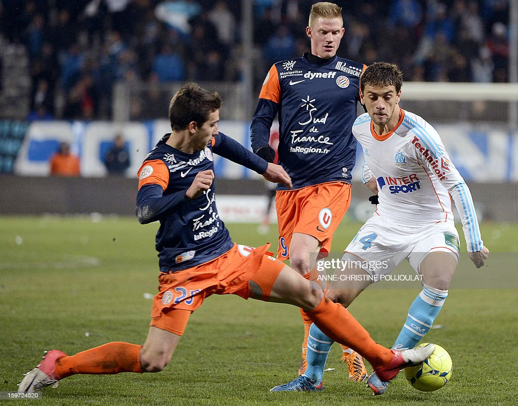 Montpellier's French defender Mathieu Deplagne (L) vies for the ball with Marseille's Brazilian defender Lucas Mendes (R) on January 19, 2013, at the Velodrome stadium in Marseille, southern France, during the French L1 football match between Marseille and Montpellier.