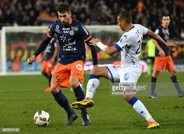 Montpellier's French defender Mathieu Deplagne vies with Bastia's French defender Alexander Djiku during the French Ligue 1 football match between...