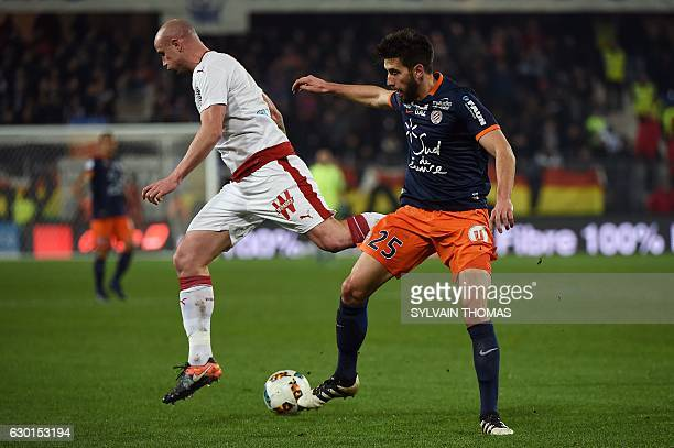 Montpellier's French defender Mathieu Deplagne vies with Bordeaux's French defender Nicolas Pallois during the French L1 football match between...