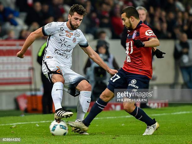Montpellier's French defender Mathieu Deplagne vies with Lille's French midfielder Naim Sliti during the French L1 football match Lille vs...