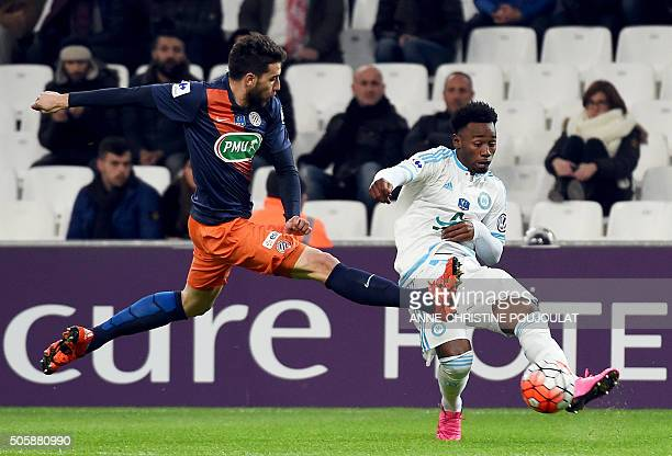 Montpellier's French defender Mathieu Deplagne vies with Marseille's French midfielder GeorgesKevin Nkoudou during the French Cup football match...