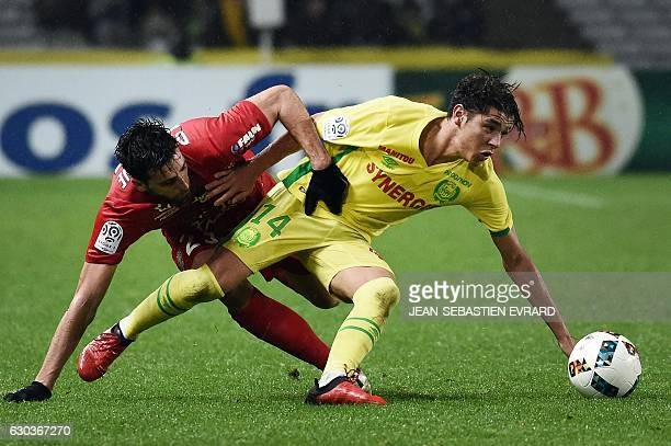Montpellier's French defender Mathieu Deplagne vies with Nantes' French midfielder Amine Harit during the French L1 football match between Nantes and...