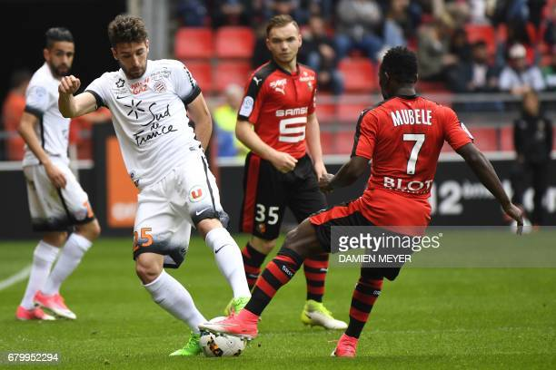 Montpellier's French defender Mathieu Deplagne vies with Rennes' Congolese forward Firmin Mubele Ndombe during the French L1 football match Rennes...