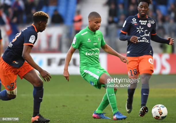 Montpellier's French defender Nordi Mukiele and Montpellier's French forward Isaac Mbenza vies with SaintEtienne's French forward Kevin MonnetPaquet...