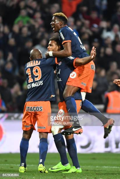 Montpellier's French defender Nordi Mukiele celebrates with teammates after scoring a goal during the French L1 football match between MHSC...