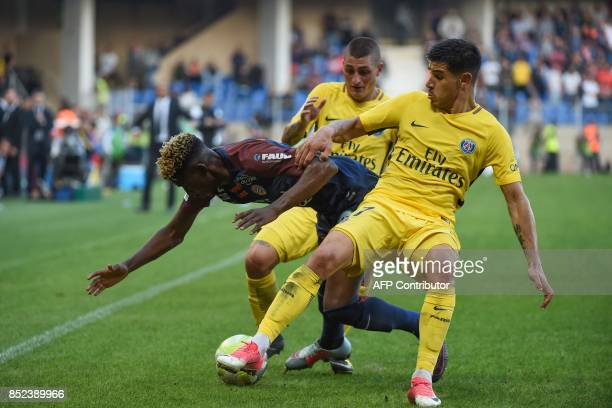 Montpellier's French defender Nordi Mukiele Paris SaintGermain's Spanish defender Yuri Berchiche and Paris SaintGermain's Italian midfielder Marco...