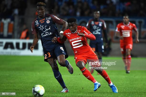 Montpellier's French defender Nordi Mukiele vies with Rennes' French midfielder Faitout Maouassa during the French L1 football match between...