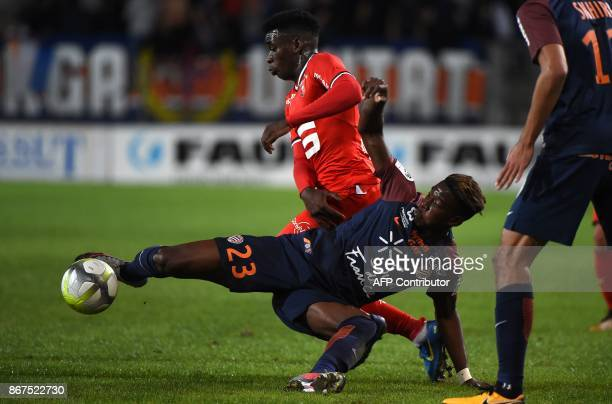 Montpellier's French defender Nordi Mukiele vies with Rennes' French midfielder Faitout Maouassa during to the French L1 football match between...