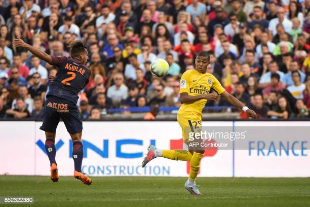 Montpellier's French defender Ruben Aguilar and Paris SaintGermain's French forward Kylian Mbappe go for the ball during the French Ligue 1 football...
