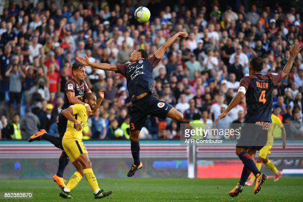 Montpellier's French defender Ruben Aguilar Paris SaintGermain's Brazilian forward Lucas and Montpellier's French defender Daniel Congré go for the...