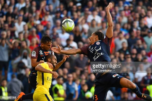 Montpellier's French defender Ruben Aguilar Paris SaintGermain's Brazilian forward Lucas and Montpellier's French defender Daniel Congré go for a...