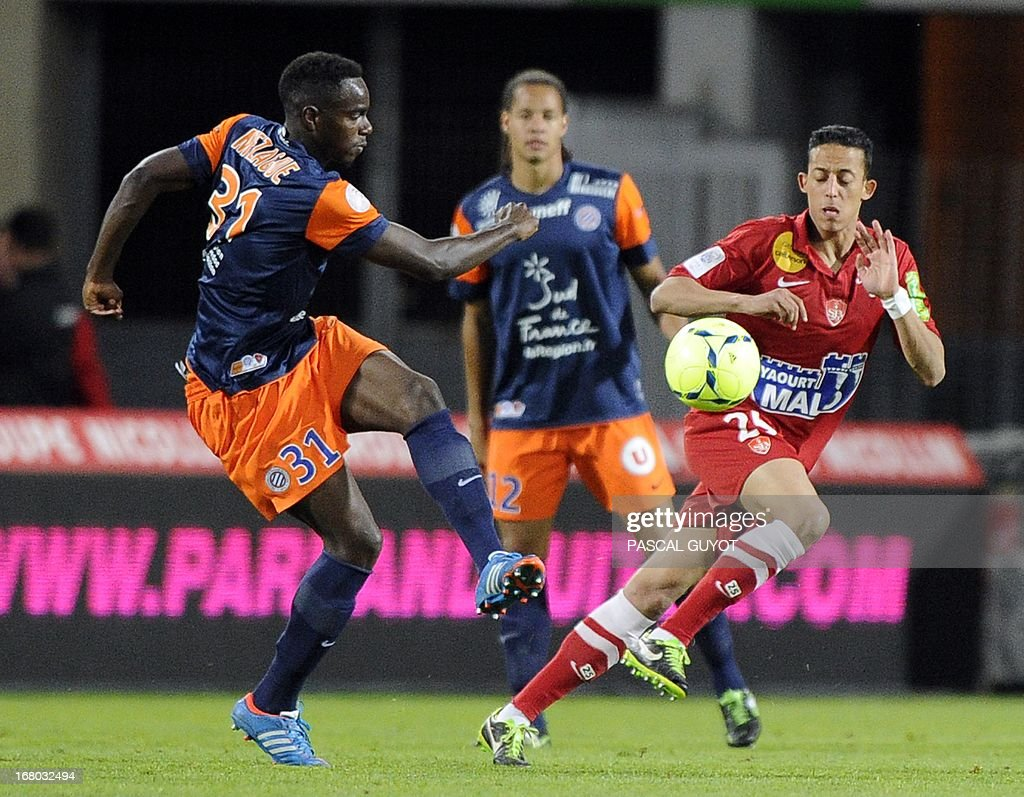 Montpellier's French defender Teddy Mezague (L) vies with Brest's French defender Brahim Ferradj (R) during the French L1 football match Montpellier vs Brest on May 4, 2013 at the Mosson stadium in Montpellier, southern France. AFP PHOTO / PASCAL GUYOT