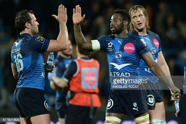 Montpellier's French flanker Fulgence Ouedraogo celebrates with Montpellier's South African hooker Bismarck Du Plessis during the French Top 14 rugby...