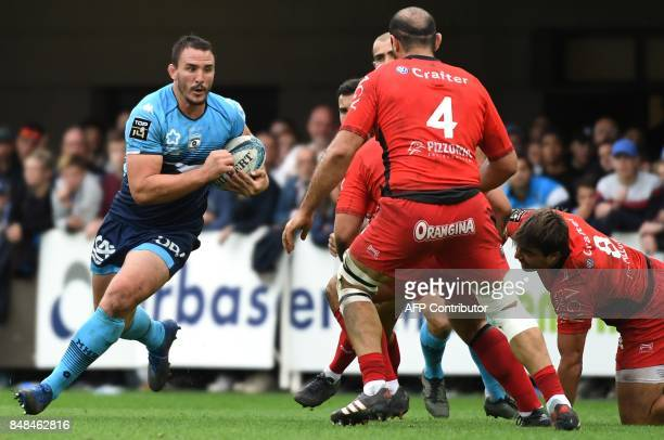Montpellier's French flanker Louis Picamole vies with RC Toulon's Georgian flanker Mamuka Gorgodze and RC Toulon's Argentinian flanker Facundo Isa...