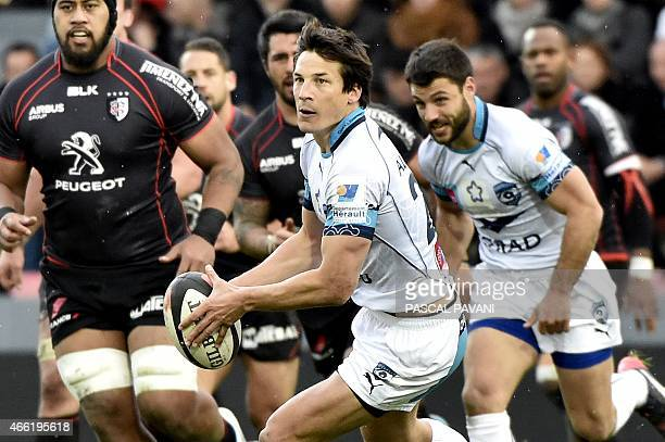 Montpellier's French flyhalf Francois TrinhDuc passes the ball during the French Top 14 rugby union match between Toulouse and Montpellier on March...