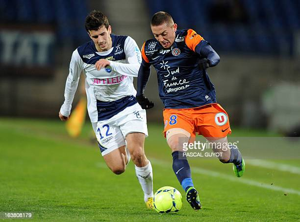 Montpellier's French forward Anthony Mounier vies for the ball with Troyes' French defender Maxime Colin during the French L1 football match...