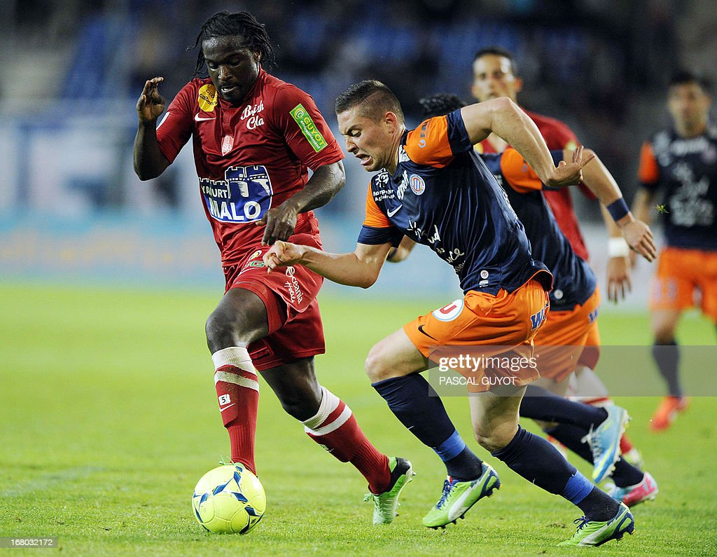 Montpellier's French forward Anthony Mounier (R) vies for the ball with Brest's French defender Bernard Mendy (L) during the French L1 football match Montpellier vs Brest on May 4, 2013 at the Mosson stadium in Montpellier, southern France.