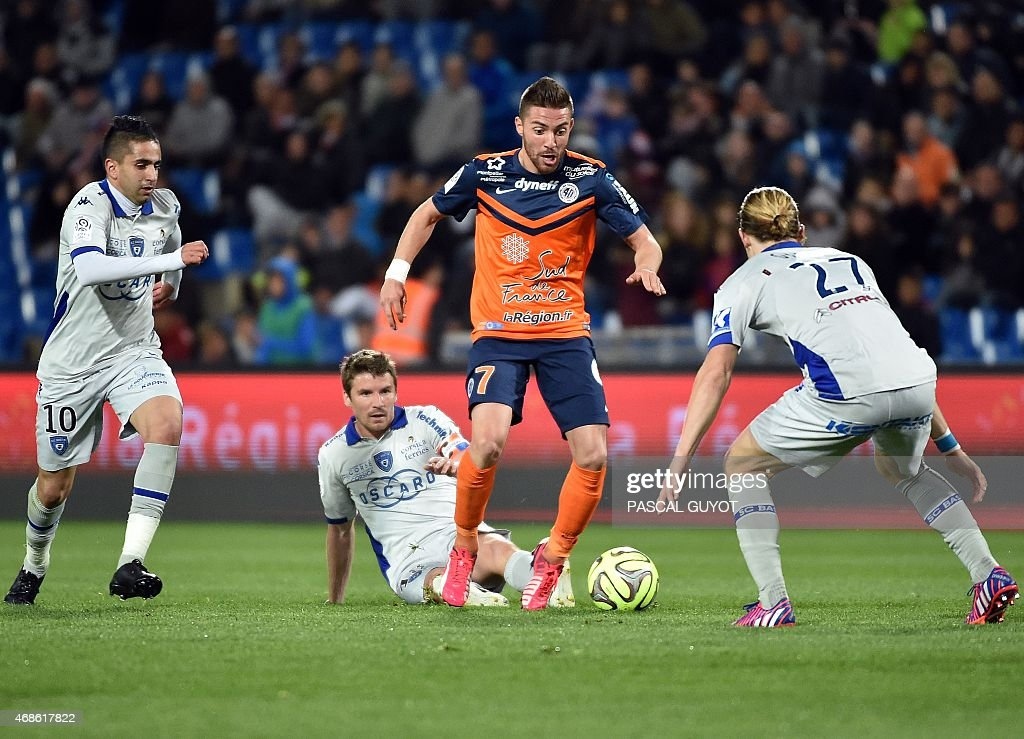 Montpellier's French forward Anthony Mounier (C) vies with Bastia's French midfielder <a gi-track='captionPersonalityLinkClicked' href=/galleries/search?phrase=Guillaume+Gillet&family=editorial&specificpeople=4542498 ng-click='$event.stopPropagation()'>Guillaume Gillet</a> (R), Bastia's French midfielder Yannick Cahuzac (L) and Bastia's Franco Algerian midfielder <a gi-track='captionPersonalityLinkClicked' href=/galleries/search?phrase=Ryad+Boudebouz&family=editorial&specificpeople=5581105 ng-click='$event.stopPropagation()'>Ryad Boudebouz</a> (10) during the French L1 football match between Montpellier and Bastia, on April 04, 2015 at the La Mosson Stadium in Montpellier, southern France.