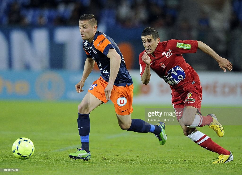 Montpellier's French forward Anthony Mounier (L) vies with Brest's French midfielder Florian Raspentino (R) during the French L1 football match Montpellier vs Brest on May 4, 2013 at the Mosson stadium in Montpellier, southern France.