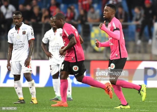 Montpellier's French forward Isaac Mbenza celebrates after scoring a goal during the French Ligtue 1 football match between MHSC Montpellier and Nice...