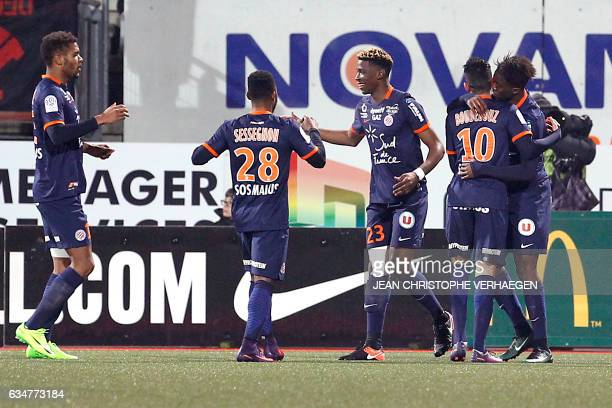 Montpellier's French forward Isaac Mbenza celebrates with his teammates after scoring a goal during the French L1 football match Nancy vs Montpellier...