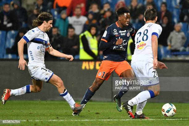 Montpellier's French forward Isaac Mbenza vies with Bastia's French defender Florian Marange and Bastia's French midfielder Yannick Cahuzac during...