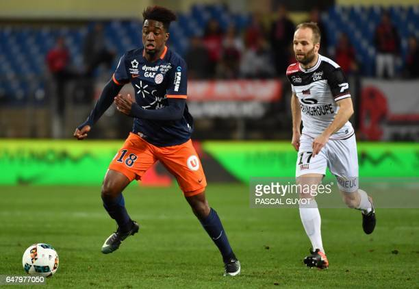 Montpellier's French forward Isaac Mbenza vies with Guingamp's French midfielder Etienne Didot during the French L1 football match between MHSC...