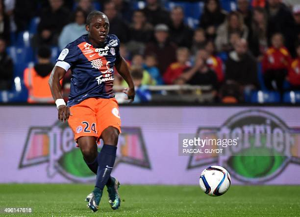 Montpellier's French forward Jerome Rousillon eyes the ball before scoring a goal during the French L1 football match between MHSC Montpellier and...