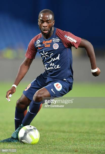 Montpellier's French forward Jonathan Ikoné runs with the ball during the French L1 football match between MHSC Montpellier and Nantes on September 9...