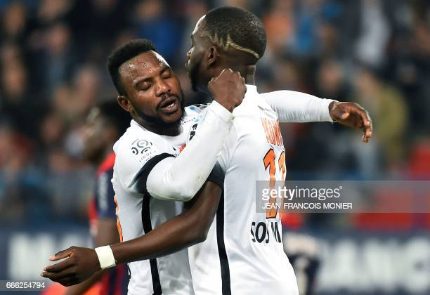 Montpellier's French forward Jonathan Ikone celebrates with Montpellier's Beninese forward Stephane Sessegnon after scoring a goal during the French...