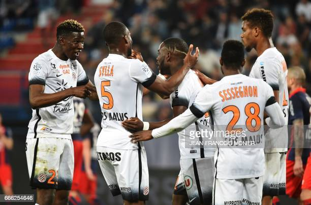 Montpellier's French forward Jonathan Ikone celebrates with teammates after scoring a goal during the French L1 football match between Caen and...